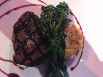 Steak, risotto and broccoli rabe.